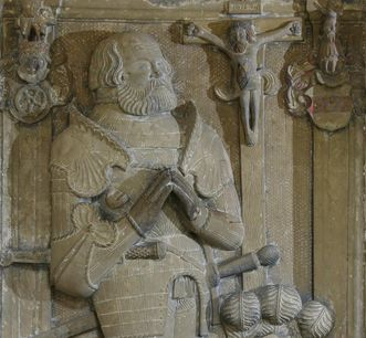 Effigy of the grave of Sir Götz von Berlichingen in the cloister of Schöntal Monastery. Image: Foto Besserer